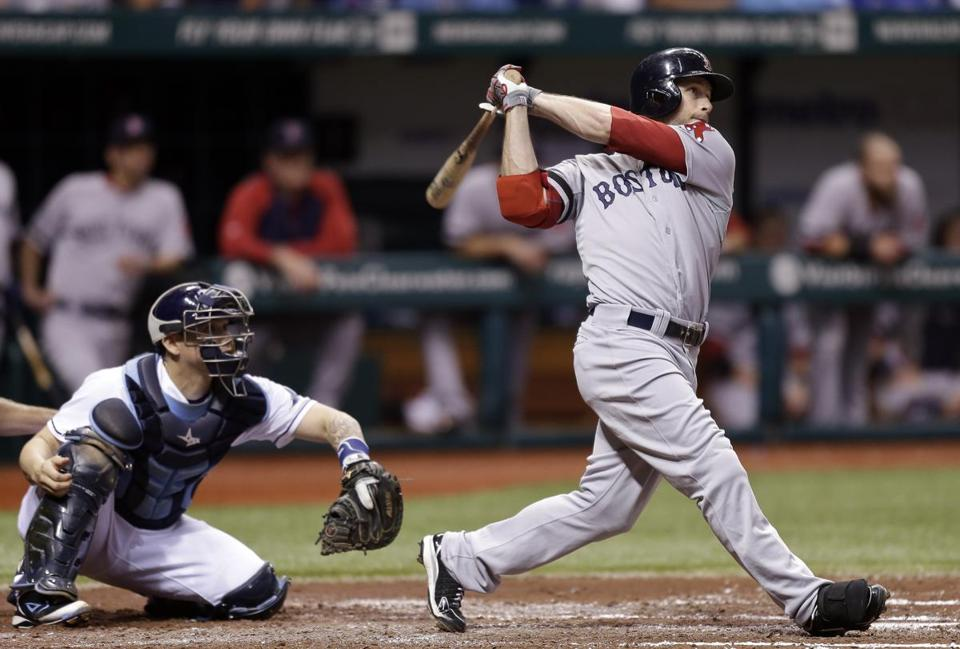 Daniel Nava follows the flight of his two-run homer off Tampa Bay's Chris Archer in the third inning of the Red Sox 2-1 win Wednesday.