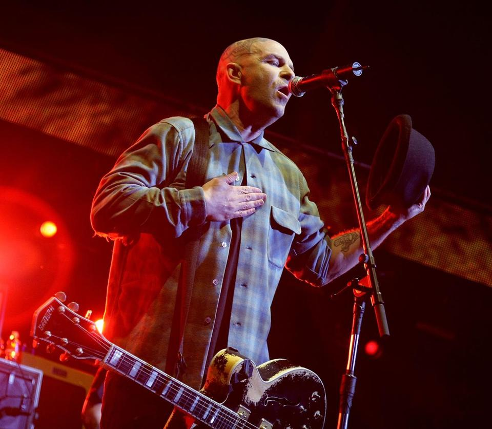 Singer Tim Armstrong (pictured performing in California) and Rancid played to a packed House of Blues Sunday.