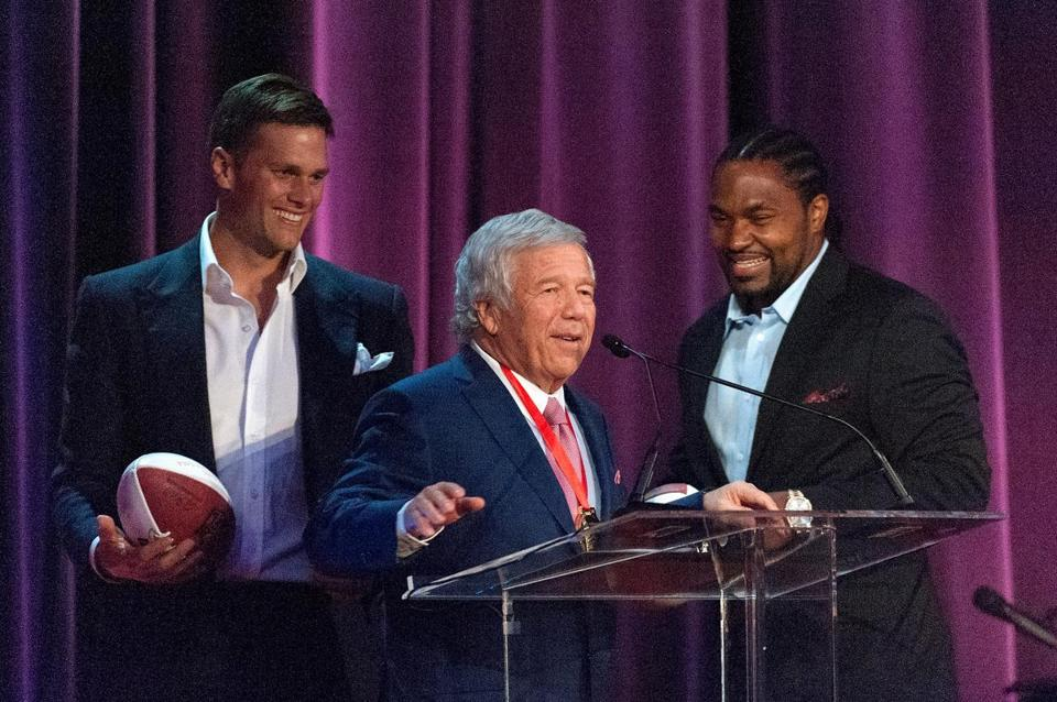 Robert Kraft accepts the award with Tom Brady and Jerod Mayo at the Waldorf Astoria in New York.