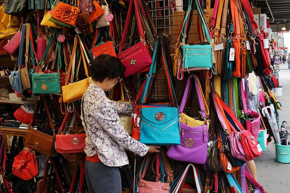 A woman shopped for bags along Canal Street in New York City, where there is a busy trade in counterfeit items.