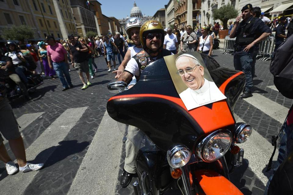 Harley-Davidson bikers with an image of Pope Francis rode in Rome near the Vatican. Motorcycle enthusiasts celebrated the 110th anniversary of the company in Rome.