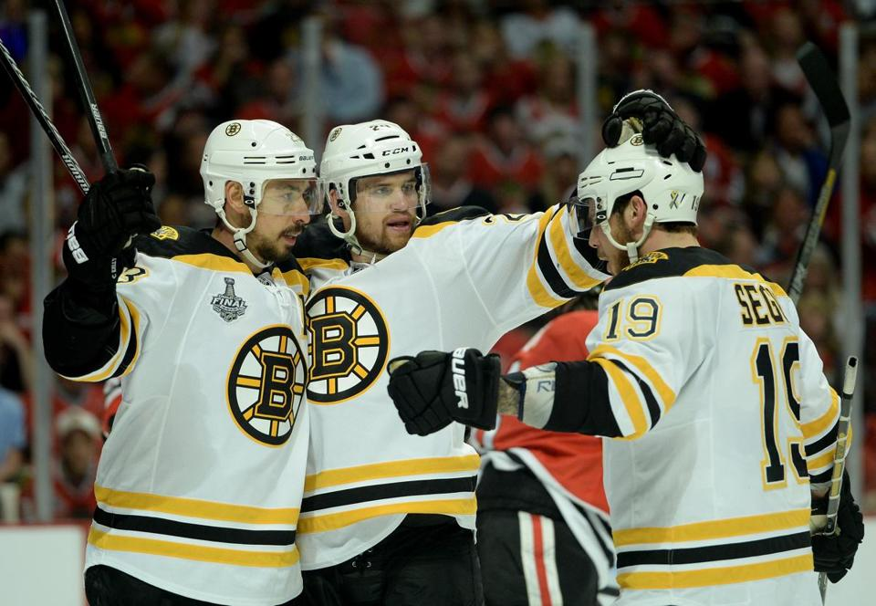 Chris Kelly (left) and Daniel Paille welcomed Tyler Seguin to the group after Kelly tied the game at 1-1 in the second.