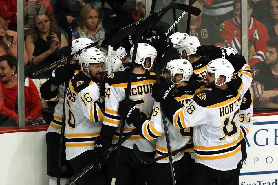 Daniel Paille, who scored the winning goal, is in the middle of this bear hug as the Bruins got together to celebrate in overtime of Game 2.