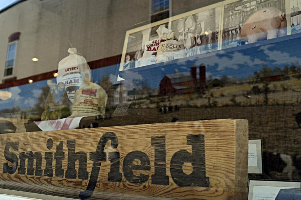 Smithfield Foods has a presence in 12 countries. Above, memorabilia displayed at a restaurant in Smithfield, Va.