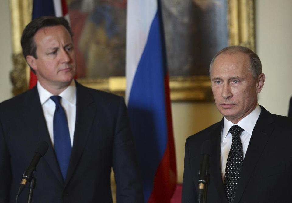 British Prime Minister David Cameron, left, and Russian President Vladimir Putin spoke at a press conference at 10 Downing Street in London.