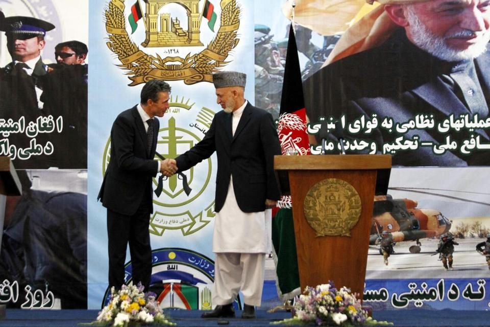 NATO Secretary General Anders Fogh Rasmussen (left) and President Hamid Karzai heralded the move.
