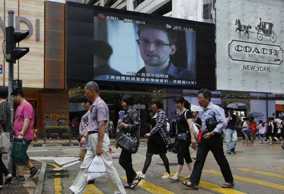 Edward Snowden was displayed on a screen at a shopping mall in Hong Kong. He has not disclosed his location but hinted he remained in the city.