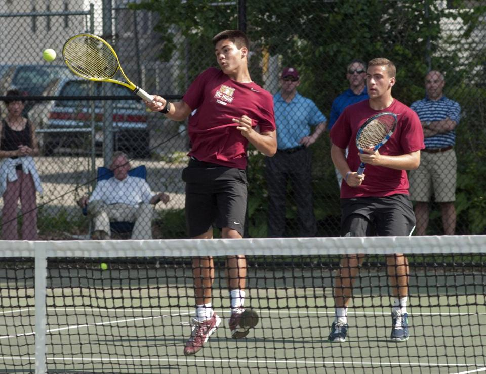 led by thr doubles team of Caye Tittmann, left, and Charles Morse, BC High won its first state title.