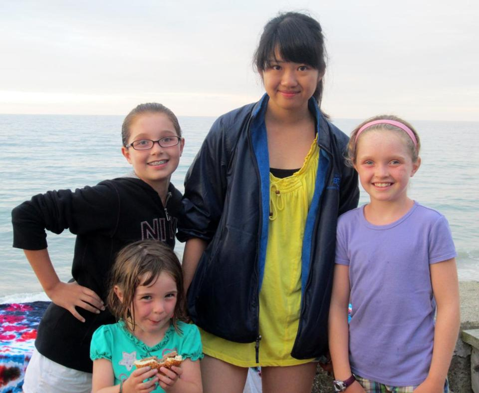 The Ananstasiades family of Hanover hosted a Japanese student last summer.  Enjoying a day at the beach were  Alex, Mia, and Kelsey Ananstasiades and Natsu Sekii.