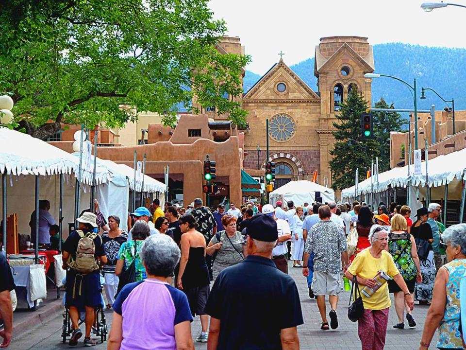 Santa Fe's cathedral looms in the background as shoppers and browsers perused the work of Spanish colonial artists during Spanish Market.
