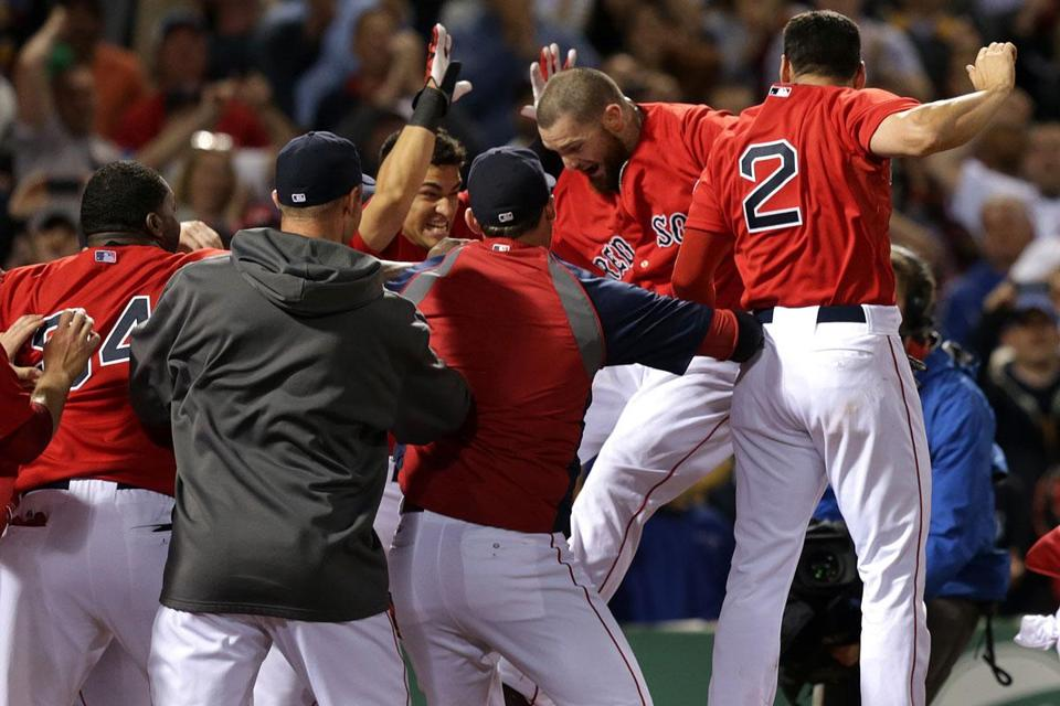 Jonny Gomes was at the center of a Red Sox celebration after his two-run walk-off homer.