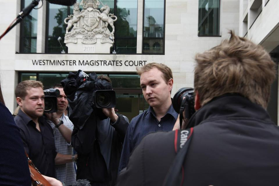 Former trader Tom Hayes, charged with eight counts of conspiracy to defraud, was surrounded by media as he left the Westminster Magistrates Court in London Thursday.
