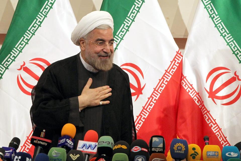Newly elected Iranian President Hassan Rowhani greeted reporters during a press conference in Tehran on Monday.