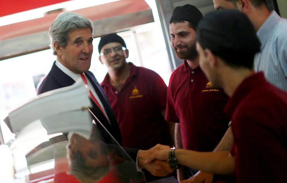 Secretary of State John Kerry meets Palestinian restaurant employees in the West Bank last month.