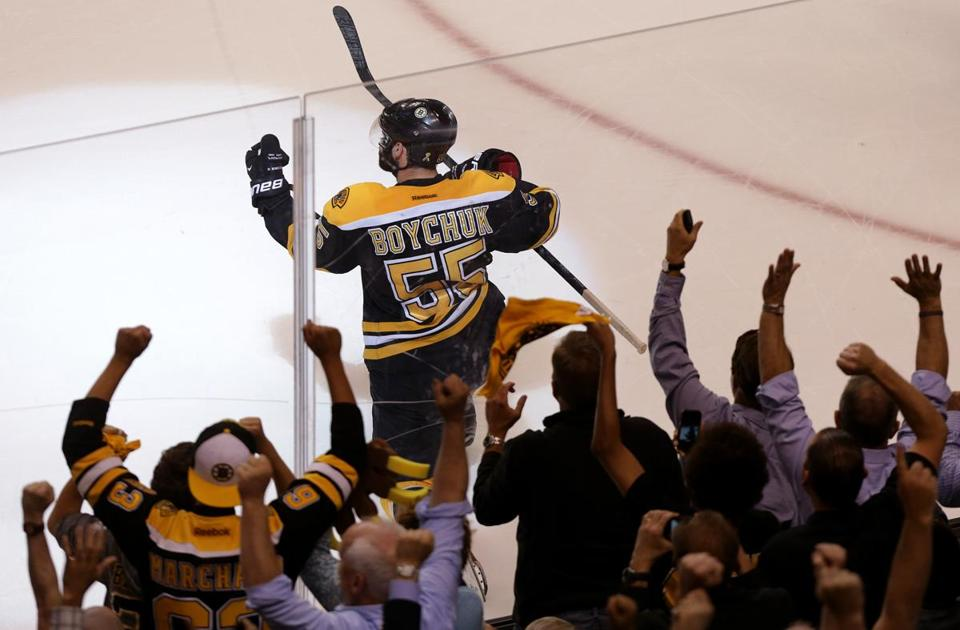 Johnny Boychuk and the fans celebrated hi third-period goal, the first by a Bruins defenseman in the series against the Blackhawks.