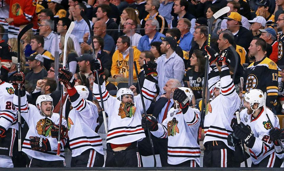 The Chicago bench goes wild after taking a 5-4 lead on Patrick Sharp's goal in the third.