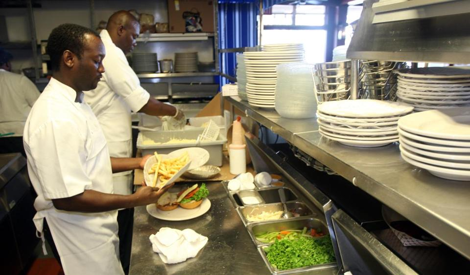 New wage laws mean higher pay for foreign workers at the Flying Bridge restaurant in Falmouth and elsewhere on the Cape and Islands.