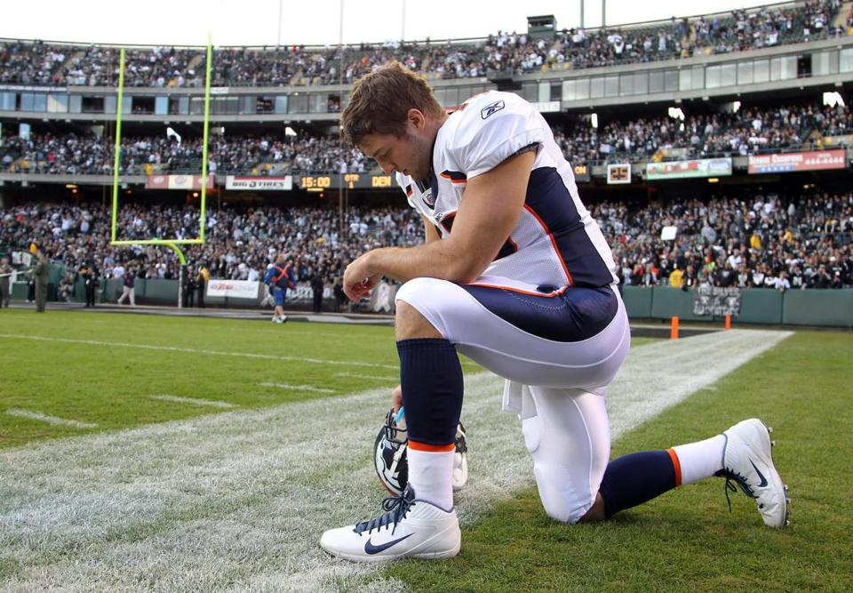 Quarterback Tim Tebow prayed before a game in 2011.