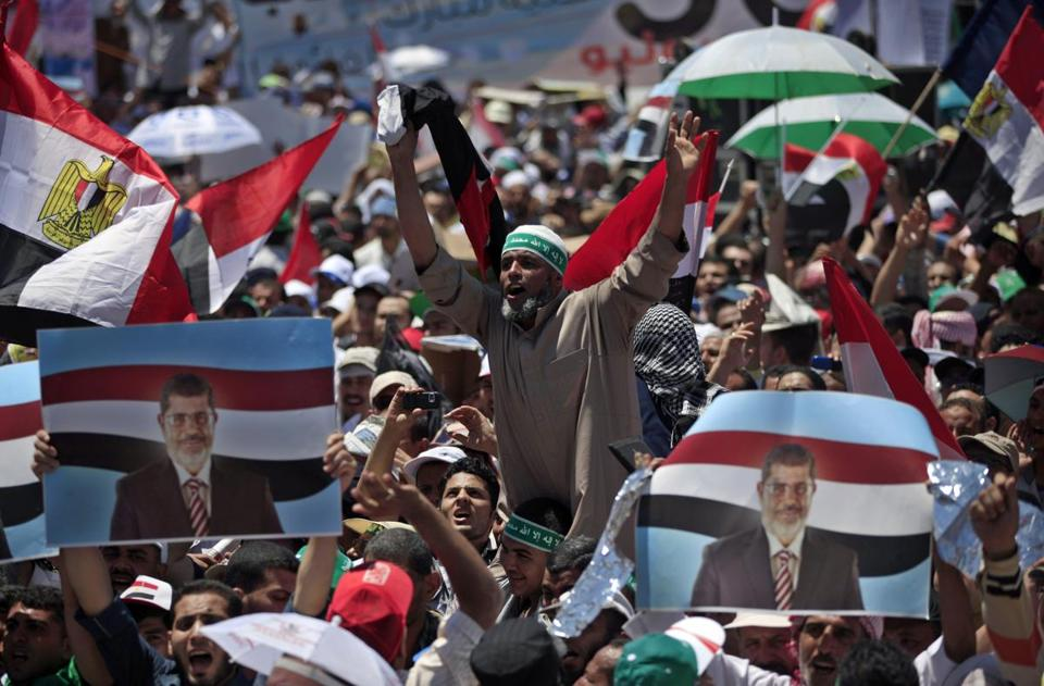 Supporters of President Mohammed Morsi rallied Friday in Cairo. Most of the participants were bused in.