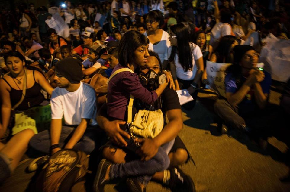 A man wearing a gas mask held his girlfriend during a demonstration in Belo Horizonte, Brazil.