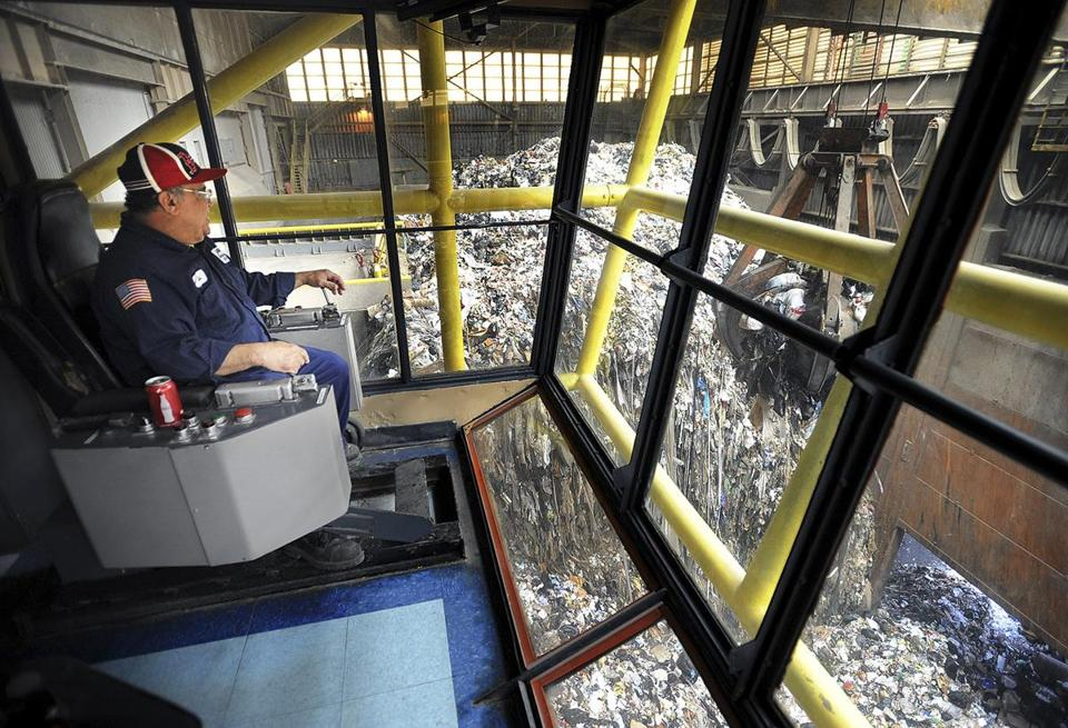 Luis Rullan guided a trash claw at Wheelabrator's Bridgeport waste-to-energy plant. The plant burns 2,200 tons a day.
