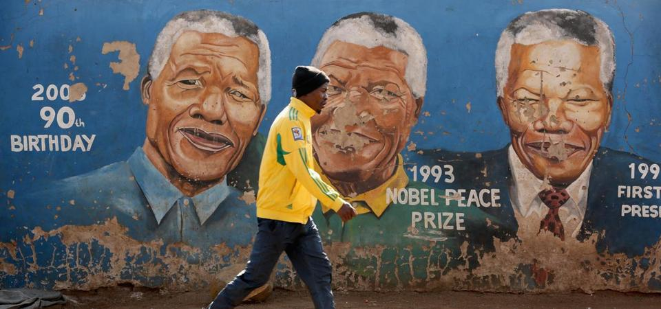 A man walked past a mural depicting former president Nelson Mandela.