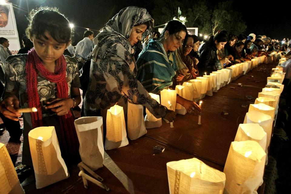 Pakistanis in Karachi lit candles Sunday during a protest to condemn the killings in the Himalayas.