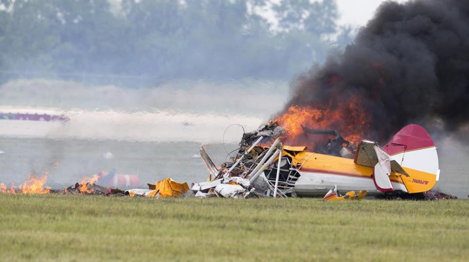 Jane Wicker and Charlie Schwenker were killed Saturday in a fiery plane crash in Dayton, Ohio. Investigators said Sunday that it was too early to rule anything out as the cause.