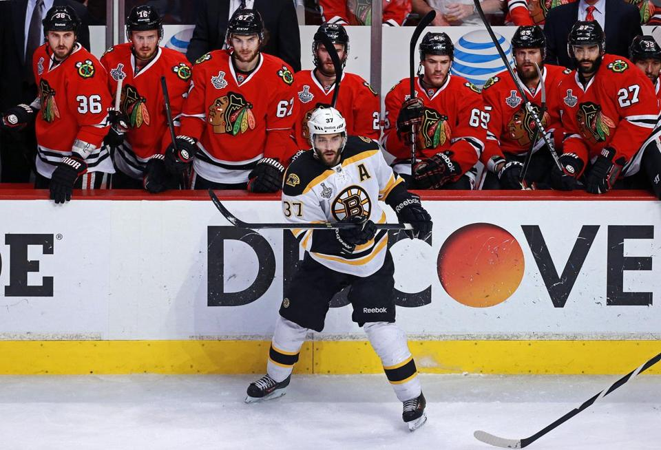 "The Blackhawks didn't see much of Patrice Bergeron in Game 5 Saturday night. The Bruins center saw only 6:06 of ice time because of what the team has termed a ""body injury."""