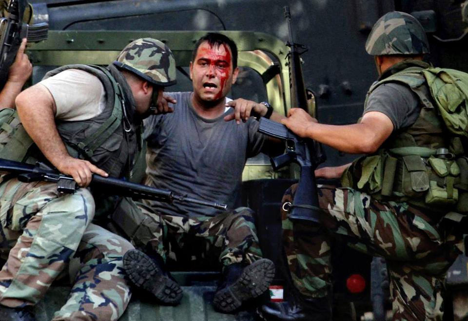 Lebanese soldiers helped an injured comrade after clashes Monday in the southern port city of Sidon.