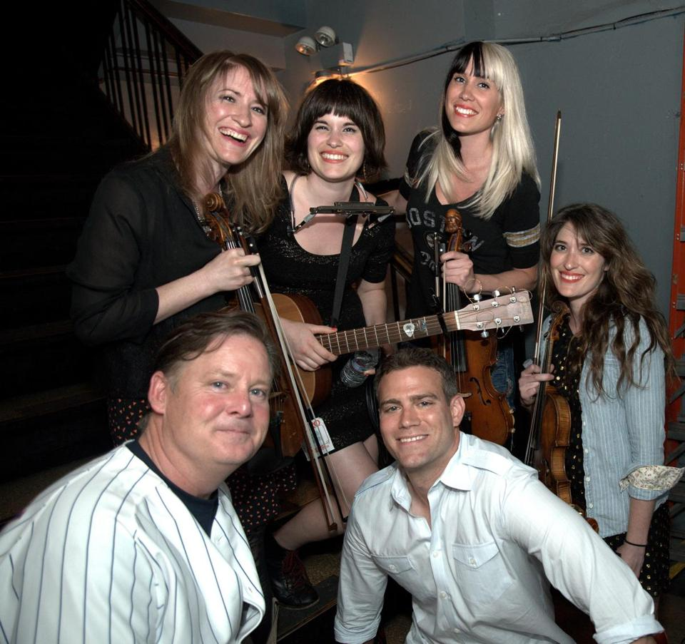 Joel Murray (left), Theo Epstein, and the band the Parkington Sisters in Chicago.