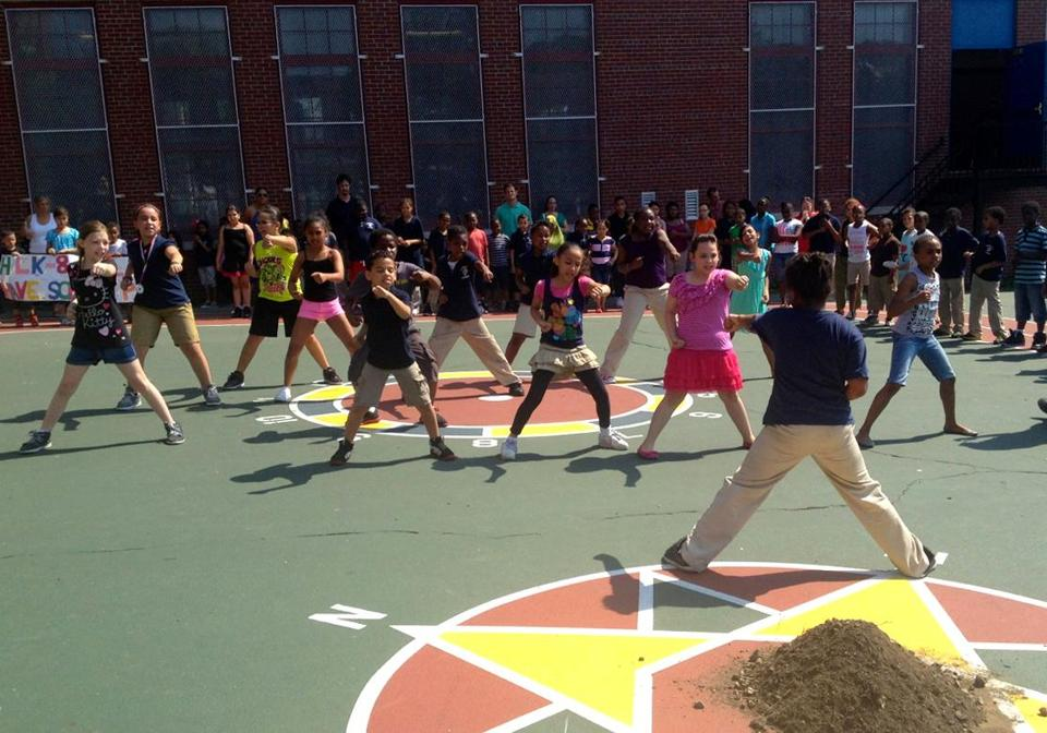 Students at Higginson-Lewis K-8 gave a tae kwon do demonstration before ground for the new schoolyard was broken.