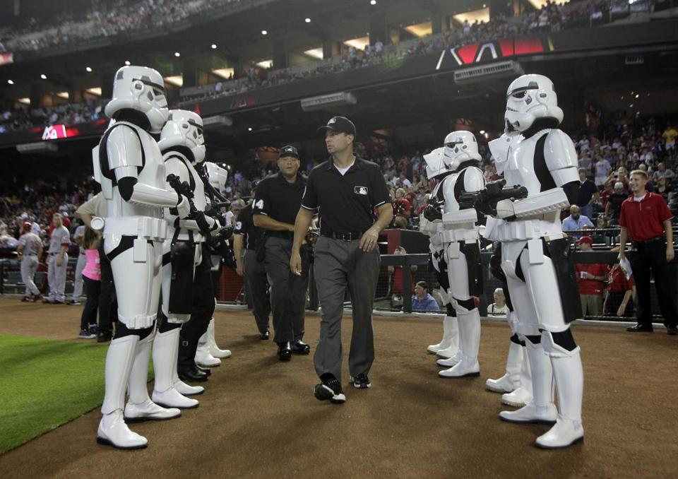 The umpires received a special escort to the diamond on Star Wars Day in Phoenix.