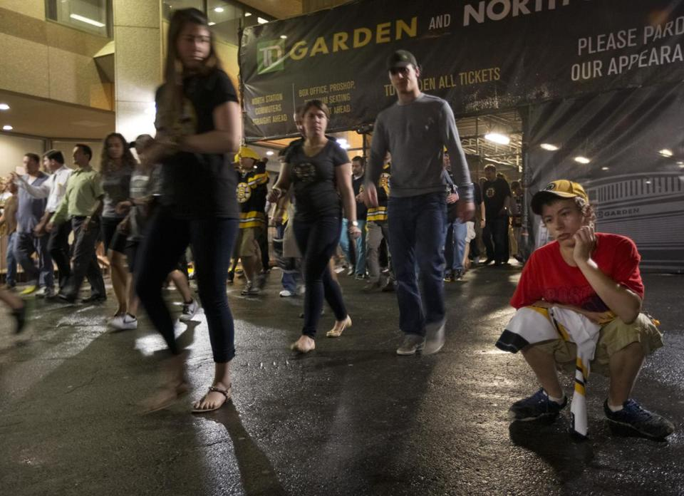 Dejected Bruins fans exited TD Garden Monday night after their team squandered a late lead, enabling the Blackhawks to capture the Stanley Cup.