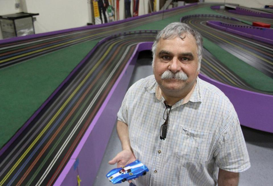 Peter Lentros stood beside the enormous slot race track from the 1960s that once sat at Playland at the Beach in San Francisco.