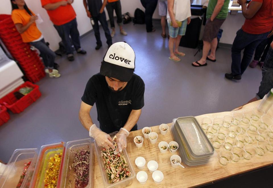 Clover Kitchen Manager Eddie Donoso, 31, prepared tasting samples June 25, 2013. A salmonella outbreak in Mass. has prompted the closure of all Clover restaurants and food trucks.