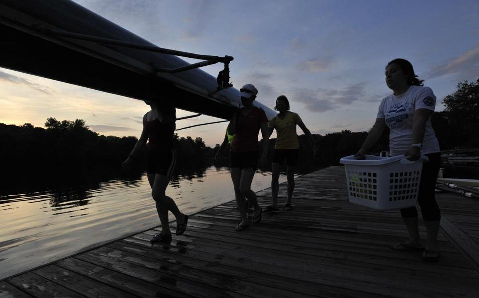 Members of Community Rowing Inc., including coxswain Amy Jackson and rowers Katie Perry and Jessica McKenna (second picture from left) enjoy an early-morning workout.