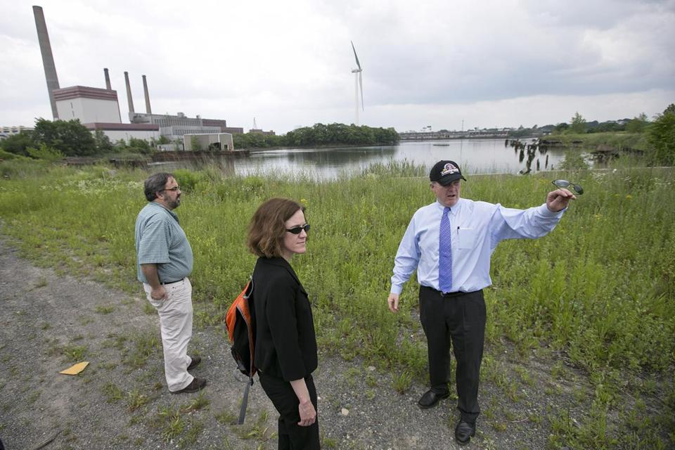 Chris Gordon (right), project manager for Wynn, toured the industrial site Wednesday with state and local officials.