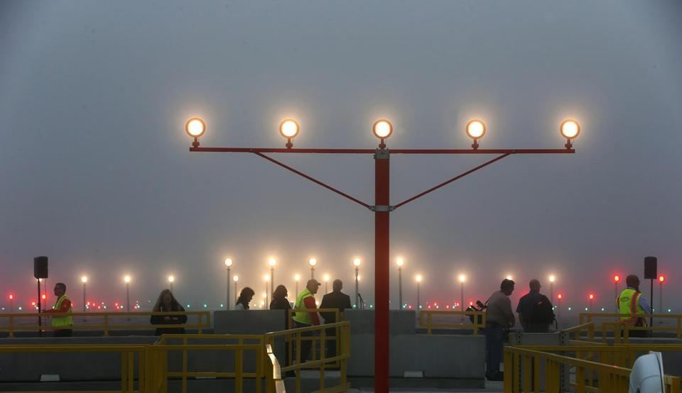 The fog on Thursday provided the ideal setting for unveiling runway upgrades that should help pilots land at Logan in similar conditions.
