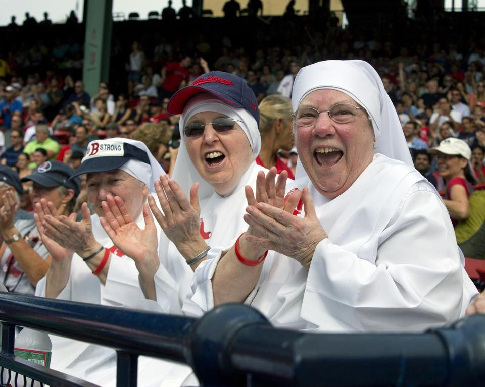 Sister Gertrude Mary (right) of the Little Sisters of the Poor in Somerville and Sister Lorraine cheer as David Ortiz hit a line drive double off the Green Monster on June 26.