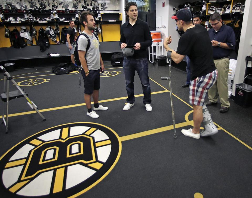 Jaromir Jagr, center, spoke with Gregory Campbell, on crutches, in the locker room on Wednesday.
