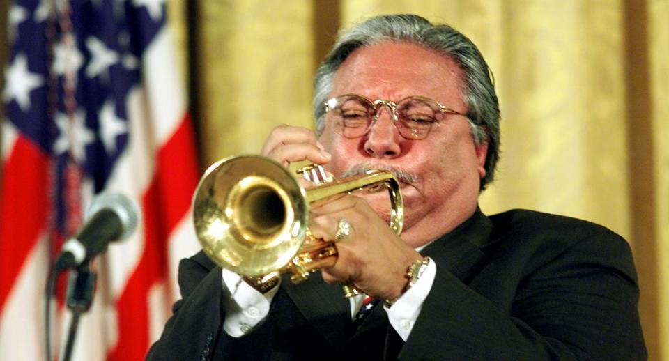 "Cuban-born trumpeter Arturo Sandoval hits the final high note of ""America The Beautiful"" while playing at the White House in 2001."