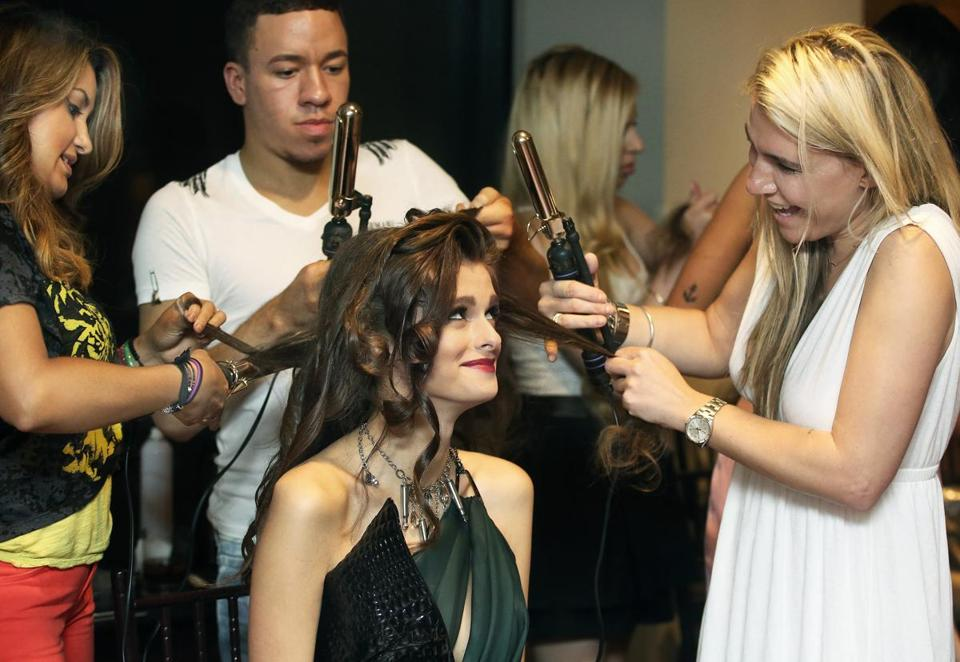 Model Yulia Romanova (above) gets ready for the show, which brought out a stylish crowd.