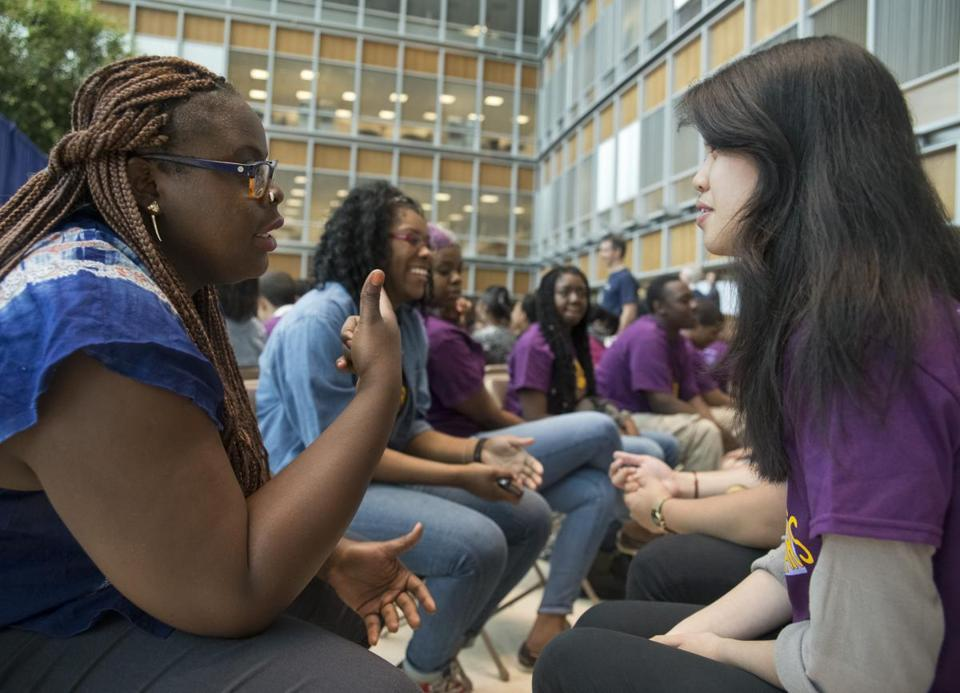 Porsha Olayiwola (left), of the MLK Summer Scholars Program, talked with Jin-Chieh Yun as the program got underway Thursday. The program is sponsored by John Hancock, along with The Boston Globe, Partners HealthCare, and Boston University.