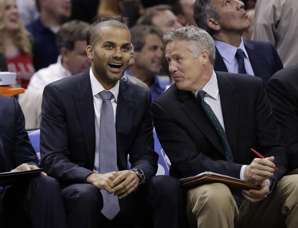 Spurs assistant Brett Brown (right, with Tony Parker), who played at BU, could end up as coach of  the Celtics or 76ers.