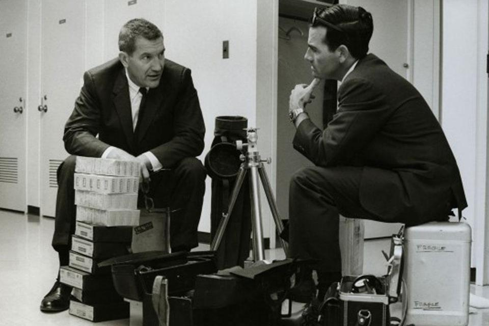 Robert E. Gilka (left) with photographer Winfield Parks Jr. and equipment before a shoot.