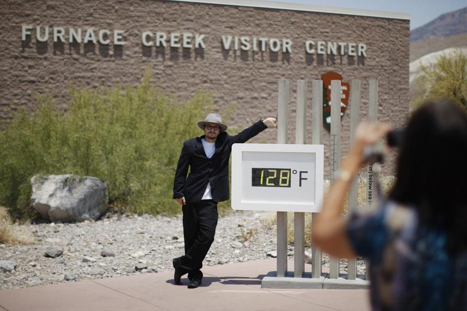A man posed at Death Valley National Park, which officially hit 127 degrees Saturday and was expected to get hotter.