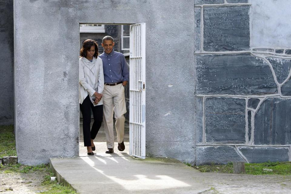President Obama and his wife, Michelle, toured the prison where South Africa's first black president spent 18 years.
