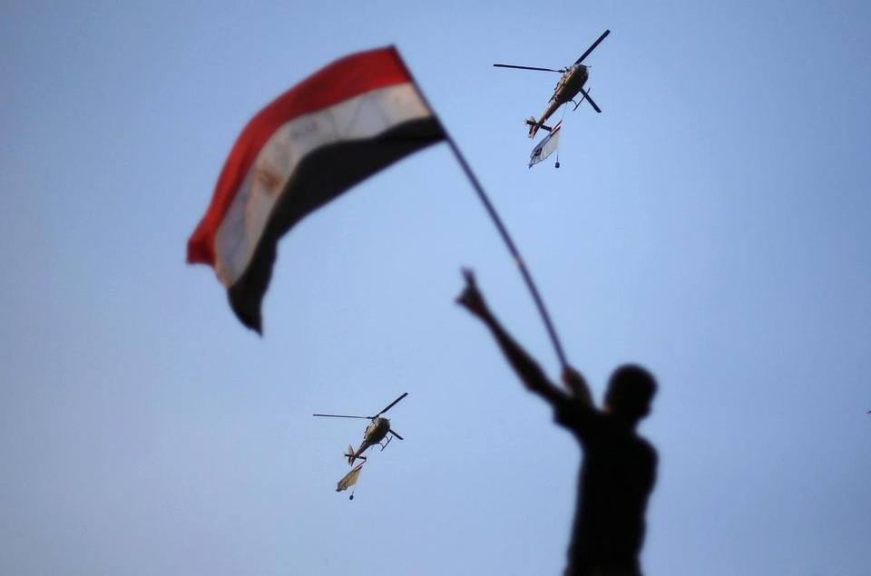 Military helicopters circled over Tahrir Square in Cairo during a protest against President Mohammed Morsi.