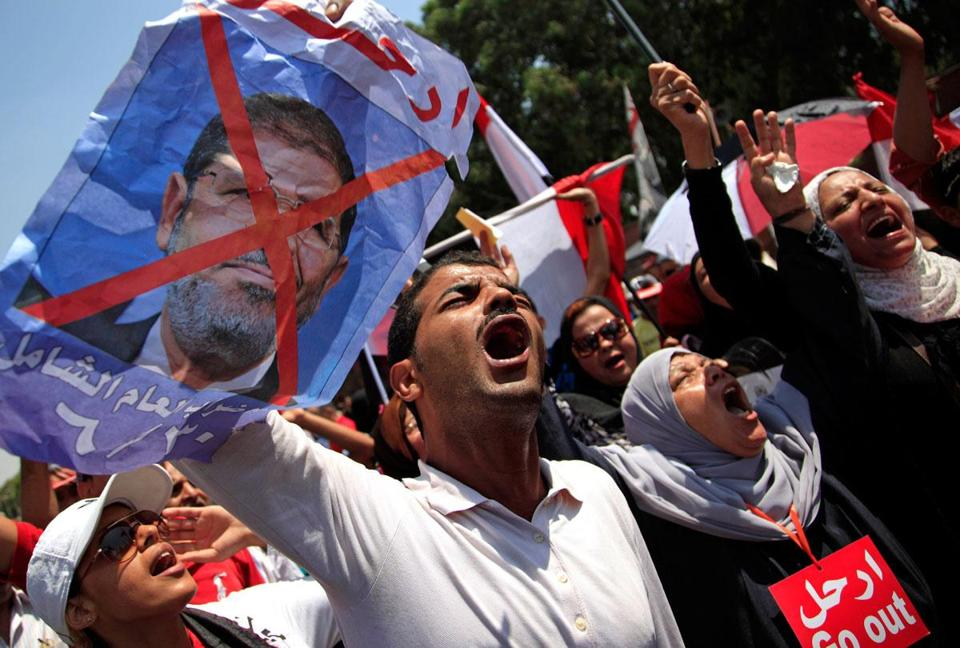 Clashes between President Mohammed Morsi's opponents and supporters killed at least 10 people and injured hundreds.
